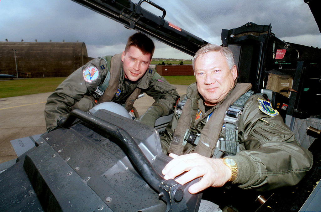 Captain (CPT), John Wilborne, USAF, F-15E Eagle aircraft pilot from the 492nd Fighter Squadron, Royal Air Force (RAF), Lakenheath, UK poses for a photograph with Dr. Benjamin S. Lambeth (seated) prior to an orientation flight. Dr. Lambeth a senior staff member at the RAND Corporation and former Director of RANDS International Security and Defense Policy has published more than six dozen reports and articles on Soviet and Russian military affairs, air power, and other defense matters and has lectured widely on these subjects. Dr. Lambeth is visiting RAF Lakenheath for an F-15E Eagle aircraft orientation flight, with the 492ND Fighter Squadron