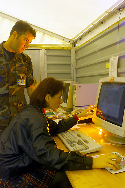 Lieutenant Steve Shape, USAF, 621 AMOS (Air Mobility Operations Squadron), McGuire Air Force Base, New Jersey, and Ms Kathy MacCleod (GS-13), Warrior Prep Center at Eisiedlerhof Air Station, Germany, review new technology and procedures to get information on operational assessment to the theater commander during a war or conflict