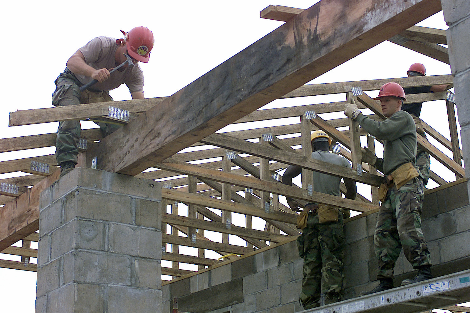Team New Horizons working together in a multinational effort to build the roof at Las Palmas School, Paraguay, during Exercise NEW HORIZONS. Combined Task Force Guarani Springs conducts engineer and medical operations in Paraguay, enabling joint training. The task force will renovate, construct and improve the infrastructure of four schools, four water wells, two medical clinics, and conduct multiple Medical Readiness Training Exercises (MEDRETES), and Veterinarian Readiness Training Exercises (VETRETES) as agreed to by the government of Paraguay