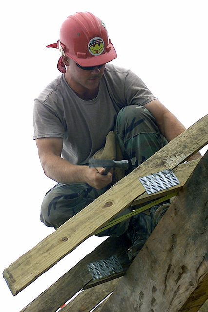 US Air Force AIRMAN First Class Josh Walker from the 823rd Red Horse Squadron, Hurlbert Field, Florida, nails down a roof truss during the construction of the Las Palmas School, Paraguay, Exercise NEW HORIZONS. Combined Task Force Guarani Springs conducts engineer and medical operations in Paraguay enabling joint training. The task force will renovate, construct and improve the infrastructure of four schools, four water wells, two medical clinics, and conduct multiple Medical Readiness Training Exercises (MEDRETES), and Veterinarian Readiness Training Exercises (VETRETES) as agreed to by the government of Paraguay