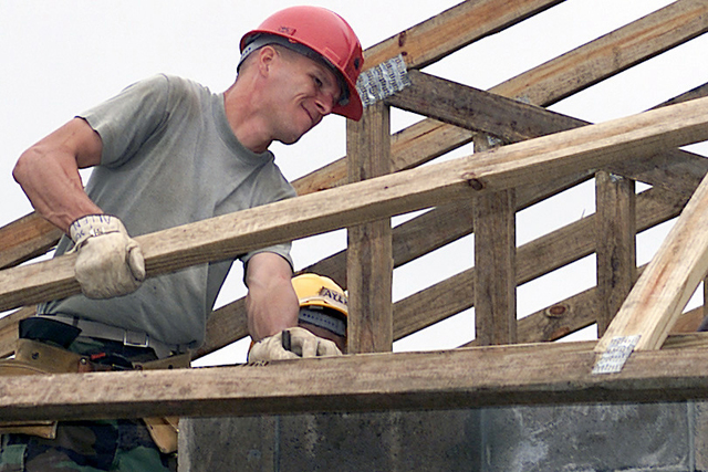 US Marine Corps Sergeant Donald Allen, from Marine Wing Support Squadron 271, Cherry Point, North Carolina, moves a roof truss into place during the construction of the Las Palmas School, Paraguay, Exercise NEW HORIZONS. Combined Task Force Guarani Springs conducts engineer and medical operations in Paraguay, enabling joint training. The task force will renovate, construct and improve the infrastructure of four schools, four water wells, two medical clinics, and conduct multiple Medical Readiness Training Exercises (MEDRETES), and Veterinarian Readiness Training Exercises (VETRETES) as agreed to by the government of Paraguay