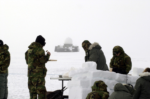 "Students of the Arctic Aircraft Recovery School (a.k.a. ""Kool School"") sponsored by the 109th Airlift Wing (AW) take a break from their training. Students take part in a 4-day school preparing them for Arctic survival and recovery of disabled LC-130 aircraft. The school is located on the Ice cap of Greenland just three miles from the abandoned DYE II site, it was part of the DEW (Distant Early Warning) Line"