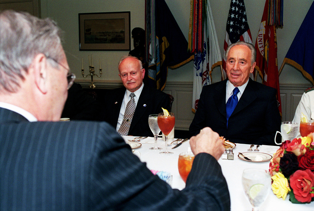 The Honorable Donald H. Rumsfeld, U.S. Secretary of Defense (foreground), meets with Israeli Foreign Minister Shimon Peres (right) and Israeli Ambassador to the United States David Ivry (center) during a working dinner at the Pentagon, Washington D.C., on May 3, 2001.(DoD photo by Robert D. Ward) (Released)