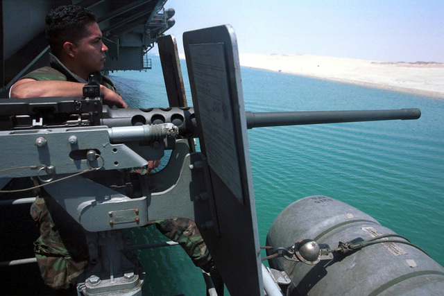 US Navy Aviation Ordnanceman Third Class Martin Gutierrez mans a fifty caliber gun mount on a Close-In Weapons System (CWIS) sponson on board USS HARRY S. TRUMAN (CVN 75) during the aircraft carrier's transit through the Suez Canal. Truman is on its maiden deployment and is scheduled to return to its homeport of Norfolk, Virginia