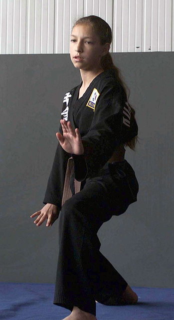 Amanda-Sue Arp daughter of STAFF Sergeant Jerry Arp, 31st Communications Squadron, network administrator, performs a karate routine, during the family fair at Aviano, Air Base, Italy