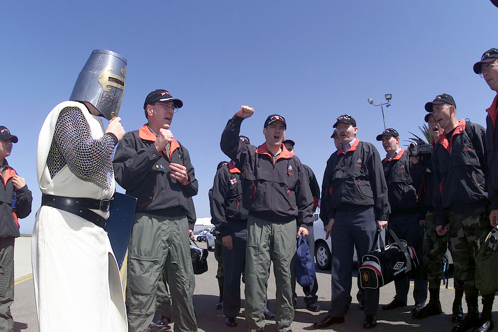 """With STAFF Sergeant Barton Bosarge, as Iron Mike, the Knights of the 21st Space Wing, Peterson Air Force Base, Colorado, celebrate the start of GUARDIAN CHALLENGE 2001 with a cheer. The cheer is led by Brigadier General Robert Kehler, (left), 21st Space Wing commander, and Lieutenant Colonel Michael Peel, (center) 21st Space Wing project officer, at Vandenberg Air Force Base, California. GUARDIAN CHALLENGE, the world's mier space and missile competition, is a four-day event hosted annually at Vandenberg AFB, CA """"to recognize the best and demonstrate the commands warfighting skills. GUARDIAN CHALLENGE creates competition-tough crews; improves readiness and combat capabilities through..."""