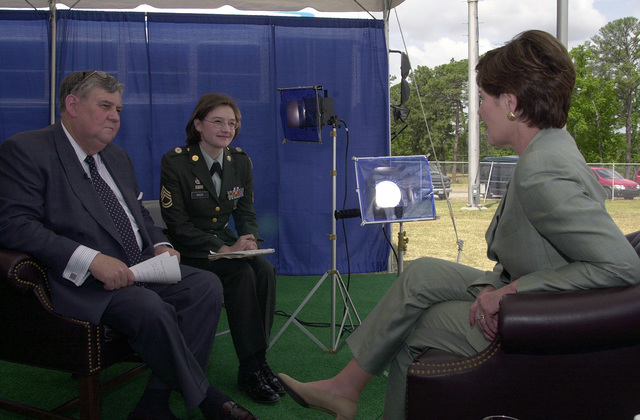"At Fort Jackson, Warren T. Lee (Left), News Director, AFRTS (Armed Forces Radio and Television Services) News Center, and Sergeant First Class Kathleen T. Rhem, USA, (Center), American Forces Press Service writer, interview First Lady Laura Bush. Mrs. Bush addressed soldiers and children at Pinckney Elementary School, Fort Jackson, South Carolina, promoting the ""Troops to Teachers"" program. The program where retired service members transition from active duty to teachers. Mrs. Bush said retired service members make great role models and some of the best teachers because of the training they receive during their time in the military"