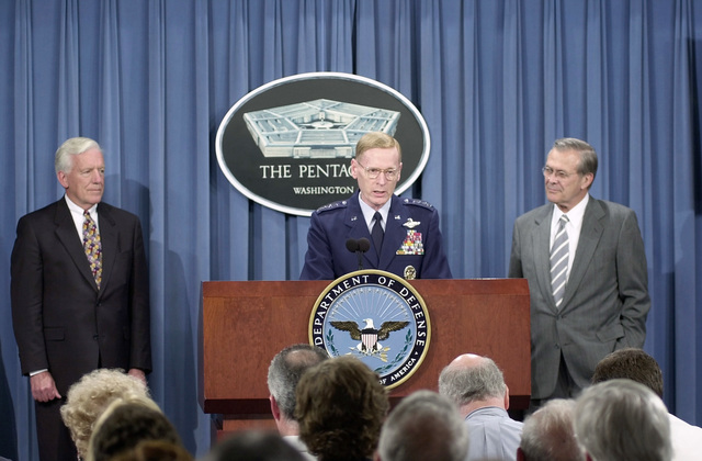 Flanked by Acting Secretary of the Air Force Dr. Lawrence J. Delaney (left) and U.S. Secretary of Defense The Honorable Donald H. Rumsfeld (right), U.S. Air Force Vice CHIEF of STAFF GEN. John W. Handy (center) answers reporter's questions in the Pentagon press room, after a report announcing changes to the United States National Security Space Management and Organization, May 8, 2001. A commission recommended designating the Department of the Air Force as Executive Agent for Space within the Department of Defense giving basic jurisdiction for space related projects to the U.S. Air Force. (DoD photo by TECH. SGT. Jim Varhegy) (Released)
