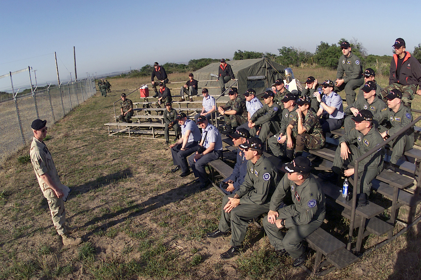 "STAFF Sergeant Mark Tipton, USAF, 20th Air Force Security Forces, F.E. Warren Air Force Base, Wyoming, briefs the 21st Space Wing ""Knights,"" Peterson Air Force Base, Colorado, on what the security forces team will encounter at the tactics event, during GUARDIAN CHALLENGE 2001 at Vandenberg Air Force Base, California. GUARDIAN CHALLENGE, the world's premier space and missile competition, is a four-day event hosted annually at Vandenberg AFB, CA ""to recognize the best and demonstrate the commands warfighting skills. GUARDIAN CHALLENGE creates competition-tough crews; improves readiness and combat capabilities through preparation, innovation and sharing; enhances esprit de corps and..."