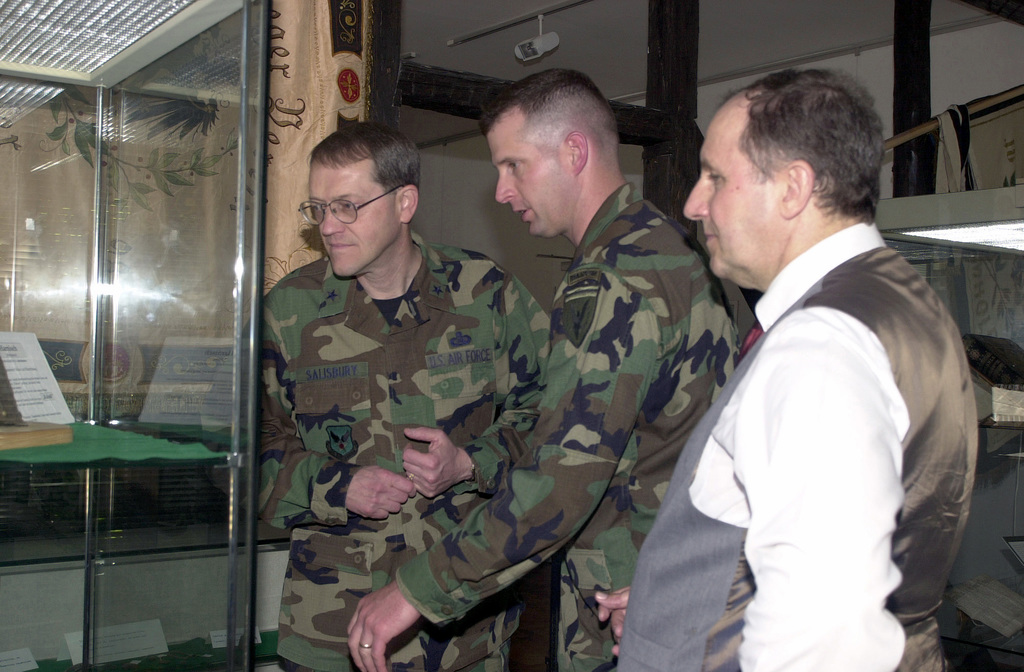 Taking a little break from COMBINED ENDEAVOR 2001 with the Mayor of Baumholder, Herr Volkmar Pees, Brigadier General Gary L. Salisbury, USAF, (left), U.S. Air Force Director, Command Control and Communications Systems, Lieutenant Colonel James Barrineau, USA, (center), Exercise Director, examine a piece of history at a local museum in Baumholder Germany. COMBINED ENDEAVOR 2001 is the largest Communications and Information System (CIS) exercise in the world. The exercise is held every year to test and document the interoperability of 35 different nations