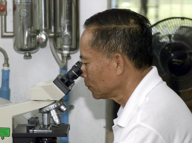 Sung Muang Piyaphory, Micro Biology technician for the Armed Forces Resours Institute of Medical Science, tests samples of bactera during Exercise COBRA GOLD 2001. COBRA GOLD is a multilateral exercise that includes more than 10,000 participants, 45 aircraft and 9 ships from the United States military, the Royal Thai Armed Forces, and the Singaporean Armed Forces. COBRA GOLD is the largest multilateral military exercise held in Southeast Asia and is designed to improve the armed forces' ability to work together during peace enforcement operations and to conduct humanitarian assistance programs throughout the exercise area