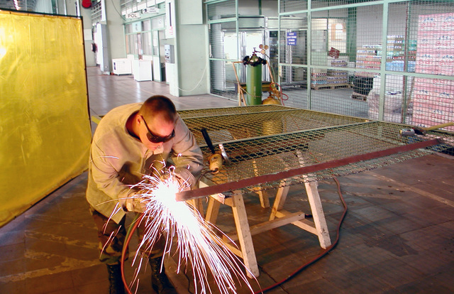 """STAFF Sergeant John Douglas, USAF, cuts the frame of a metal cage door as part of a project to expand a storage area at the U.S. Air Force detachment at Istres Air Base, France. """"The United States has agreed to provide a force of approximately 6,900 U.S. Service member to help maintain a capable military force in Bosnia-Herzegovina. No timetable for the duration of Operation JOINT FORGE has been determined. The mission will be assessed periodically and the force size will be adjusted, as circumstances require."""""""
