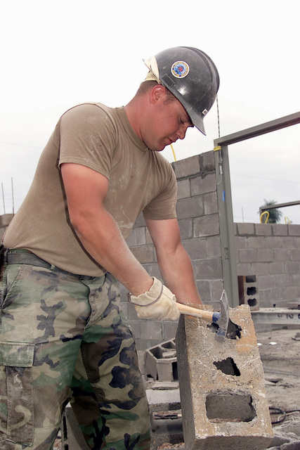 US Navy Still Worker Third Class Joshua Ancelet from the Naval Mobil Construction Battalion 74, Seabee Sea Gulf Port, Mississippi, brakes holes on blocks for the construction of a new school in San Antonio Clinic, Paraguay, during Exercise NEW HORIZONS. Combined Task Force Guarani Springs conducts engineer and medical operations in Paraguay, enabling joint training. The task force will renovate, construct and improve the infrastructure of four schools, four water wells, two medical clinics, and conduct multiple Medical Readiness Training Exercises (MEDRETES), and Veterinarian Readiness Training Exercises (VETRETES) as agreed to by the government of Paraguay