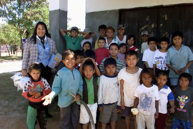 Professor Raquel Ramos and the children from Indigena Juan Diego School, Barrio Redencion, Concepcion, Paraguay, are happy to receive donated school supplies during Exercise NEW HORIZONS. Combined Task Force Guarani Springs conducts engineer and medical operations in Paraguay, enabling joint training. The task force will renovate, construct and improve the infrastructure of four schools, four water wells, two medical clinics, and conduct multiple Medical Readiness Training Exercises (MEDRETES), and Veterinarian Readiness Training Exercises (VETRETES) as agreed to by the government of Paraguay