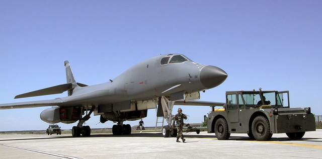 Using an aircraft tug the maintenance crews tows a B-1B Lancer bomber from the Kansas Air National Guard to its parking spot. The Lancer arrived to participate in the Istres Air Show on May 20, 2001. The bomber is assigned to the 184th Bomb Wing, McConnell Air Force Base, Kansas. Other U.S. Air Force aircraft on display at the Istres, France Air Show are the C-17 Globemaster III airlifter and two F-15 E Strike Eagle fighters