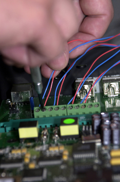 """Vadim Peterman of Estonia makes adjustments to a circuit board, in Lager Aulenbach, Germany. This is part of COMBINE ENDEAVOR 2001, the largest communications and information systems exercise in the world. The exercise, sponsored by US European Command and hosted by Germany in the spirit of """"Partnership for Peace,"""" is held annually to test and document the interoperability of dozens of nations and NATO. There are 37 countries participating this year"""