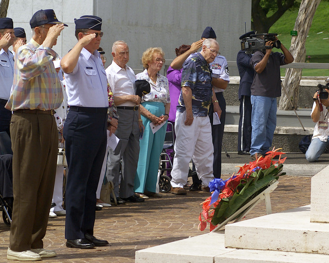 Major General (MGEN), Thomas C. Waskow, USAF, Director of Air and Space Operations, Hickam AFB, HI and a original member of the Doolittle Raiders, salute after they placed a wreath at the War Memorial, during a Wreath laying Ceremony at the National Memorial Cemetery of the Pacific at Honolulu, Hawaii