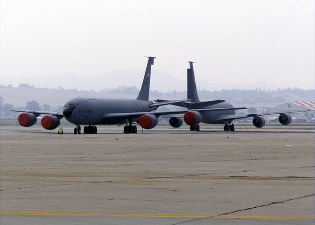 A pair of KC-135R Stratotankers from Fairchild Air Force Base (AFB) sit tail to tail at their temporary home at March Air Reserve Base. Due to repairs to the runway at Fairchild AFB, the 92d Air Refueling Wing has relocated their flying operations to March ARB