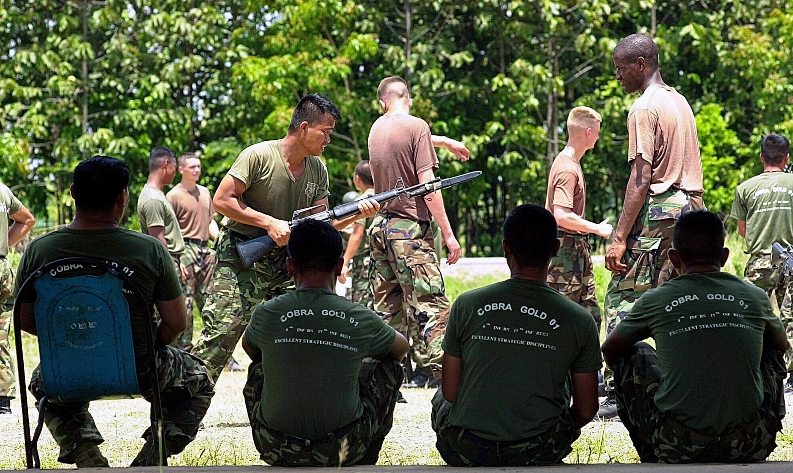 US Army soldiers from the 1ST Special Forces Group, Fort Lewis, Washington, receive hand-to-hand combat training from members in the Royal Thai Army during this year's Exercise COBRA GOLD 2001. CG '01 is a regularly scheduled, joint-combined exercise designed to ensure regional peace and strengthen the ability of the royal Thai Armed Forces to defend Thailand or respond to regional contingencies. This year's exercise, the 20th in the series, will focus on peace enforcement operations