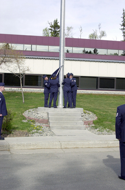 Students of the Alaska Air National Guard 176th Wing's 3rd annual Satellite NCO Academy, perform a formal retreat. The Satellite Academy consists of four months of training two nights a week, except the last two weeks which are eight hours a day and taught by an instructor from the Air National Guard Training and Education Center from McGee-Tyson. Students receive in-resident credit for the NCO Academy, but get the advantage of staying at home, and reducing costs to the Air National Guard. Students left to right are, Technical Sergeant (TSGT) Taggart J. Hooper, TSGT Sherri M. Moran, TSGT Leigh A. Norman, TSGT Lyn. M Garrett, TSGT Paul S. Bobby