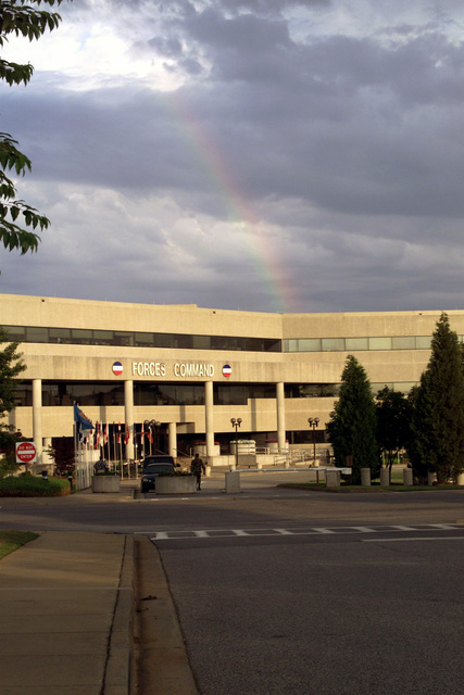 The entrance to the Headquarters US Forces Command Building, Fort McPherson, GA. A rainbow can be seen in the background
