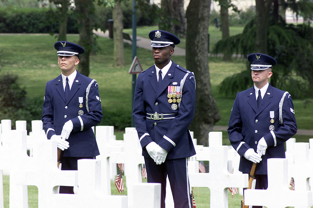 (from left to right) US Air Force SENIOR AIRMAN Mathew M. Quirin , US Air Force Captain Leo Lawson, Jr., and US Air Force SENIOR AIRMAN Draig V. Cutler, United States Air Force Honor Guard, Bolling Air Force Base, Washington, DC, participate in a Memorial Day ceremony at the Suresnes American Military Cemetery in Paris, France
