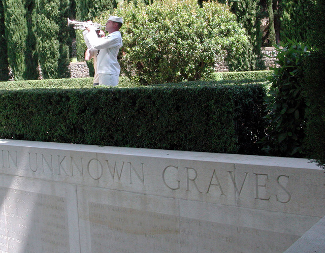 US Navy PETTY Officer 1ST Class Jim Murdock, USN, sounds Taps during the American Memorial Day in France ceremony at the Rhone American Cemetery, Draguignan, France. PO1 Murdock is a bugler with the US Navy's Sixth Fleet Band, Naples, Italy. Representatives of the US Navy, US Air Force and US Army joined the French military, French and American veterans' organizations at the ceremony. Fifty-two wreaths placed to honor the 861 American military veterans buried at Rhone who fought in southern France during World War II