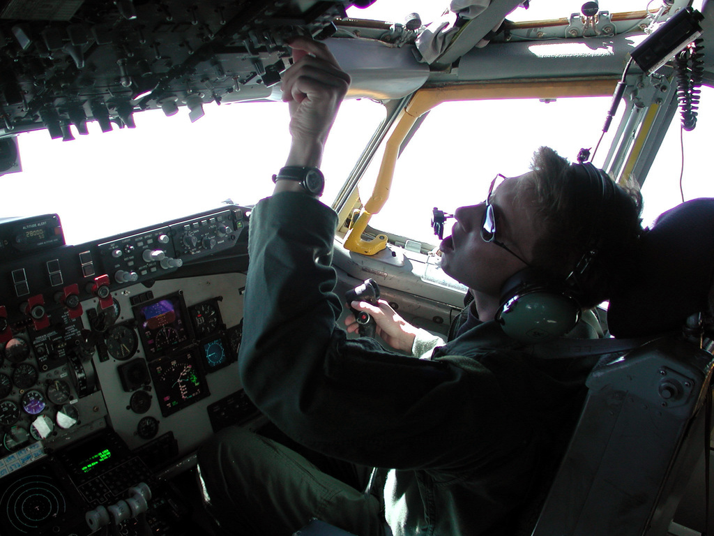 Captain (CAPT) Brad Cook, USAF, a KC-135R Stratotanker co-pilot, makes instrument adjustments during an aerial refueling mission over the Adriatic Sea. CAPT Cook deployed with about 20 other aircrew members and maintenance personnel from McConnell Air Force Base, Kansas, to the 16th Expeditionary Operations Group, a small US detachment located at Istres French air base. The McConnell active duty personnel join the primarily Air National Guard flying and maintenance operations here. The group flies aerial refueling missions in support of NATO Operation JOINT FORGE, refueling US and NATO aircraft, patrolling the Balkan region