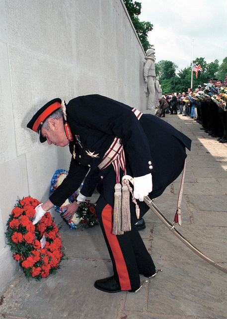 Her Majesty's Lord Lieutenant of Cambridgeshire, Mr. James Crowden lays the British wreath at the Wall of the Missing during the Madingley Memorial Day Commemorative Service. The wreaths are placed on the wall to honor the men and women buried at Cambridge American Military Cemetery, and whose names are engraved on the Wall of the Missing. The ceremony was held at Cambridge American Military Cemetery, Coton, Cambridge, United Kingdom
