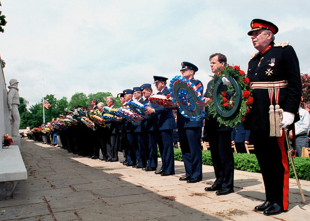 Presenters hold their wreaths during Madingley Memorial Day Commemorative Service. The presenters will then lay their wreath on the Wall of the Missing to honor the men and women buried at Cambridge American Military Cemetery, and those who's names are engraved on the Wall of the Missing. The ceremony was held at Cambridge American Military Cemetery, Coton, Cambridge, United Kingdom