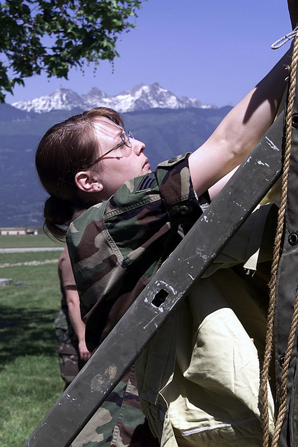 US Air Force SENIOR AIRMAN Stephanie Branscomb, 31st Medical Group, Aviano Air Base, Italy, secures the inner liner to a temper tent the 31st Med Group has erected along with members of the New Jersey Army National Guard to be used for real world sick call treatment of military members supporting the multinational training Exercise VENETO RESCUE 01, in northeast Italy and Slovenia. Veneto Rescue is an exercise that helps to train military units to conduct the safe evacuation of non-combatant civilians and other designated evacuates from a country or a region that has the potential for hostilities or danger. This type of operation is known as a non-combatant evacuation operation or NEO...