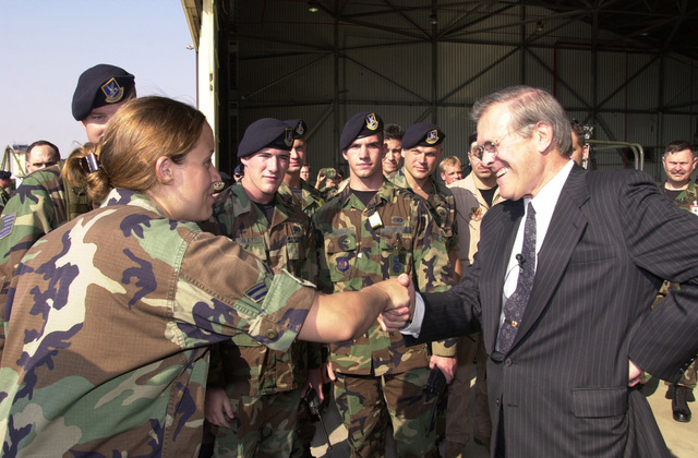 Secretary of Defense Donald H. Rumsfeld, greets US Air Force AIRMAN First Class Maurin Smith at Incirlik Air Base, Turkey. Incirlik is home to Combined Task Force/Operation NORTHERN WATCH, designed to enforce the no-fly zone over Northern Iraq