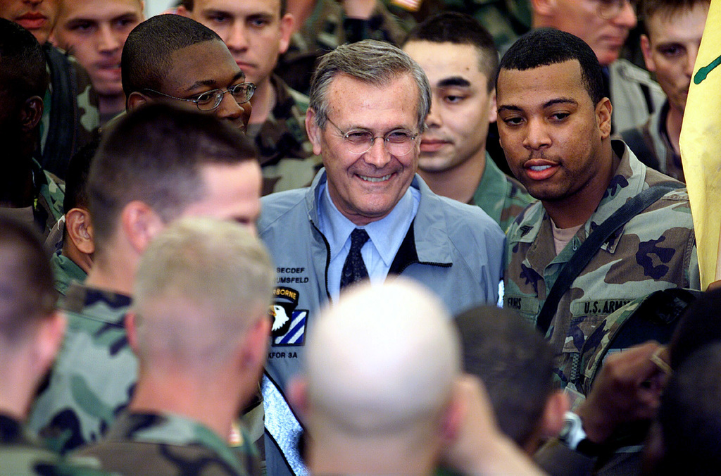 The Honorable Donald H. Rumsfeld, U.S. Secretary of Defense (center) speaks with U.S. Army Soldiers in the Camp Bondsteel main theater during his offical visit to Camp Bondsteel, Kosovo, Serbia, on June 5, 2001. (U.S. Army PHOTO by STAFF SGT. Thomas A. Lee) (Released)