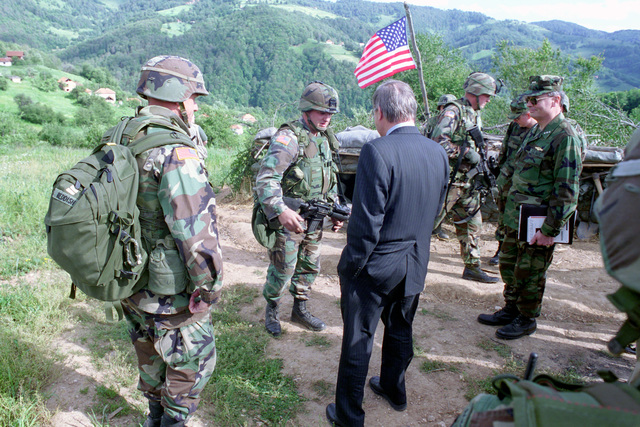 U.S. Army LT. COL. Christopher Reddish, 502nd Infantry Regiment, 101st Airborne (Air Assault) Division, gives The Honorable Donald H. Rumsfeld, U.S. Secretary of Defense, a tour of the observation post at Mijak, Kosovo on Jun. 5, 2001.  (DoD photo by Robert D. Ward) (Released)