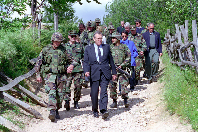 U.S. Army LT. COL. Christopher Reddish, 502nd Infantry Regiment, 101st Airborne (Air Assault) Division, leads The Honorable Donald H. Rumsfeld, U.S. Secretary of Defense, and senior members of his delegation, on a tour at the observation post, at Mijak, Kosovo on Jun. 5, 2001.  (DoD photo by Robert D. Ward) (Released)