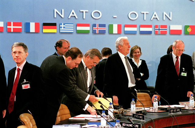 """The Honorable Donald H. Rumsfeld (3rd from left), U.S. Secretary of Defense, and NATO Ambassador, Alexander""""Sandy""""Vershbow (2nd from left), review their notes at the North Atlantic Council Defense Ministerial at NATO Headquarters in Brussels, Belgium, on Jun. 7, 2001. (DoD photo by Robert D. Ward) (Released)"""