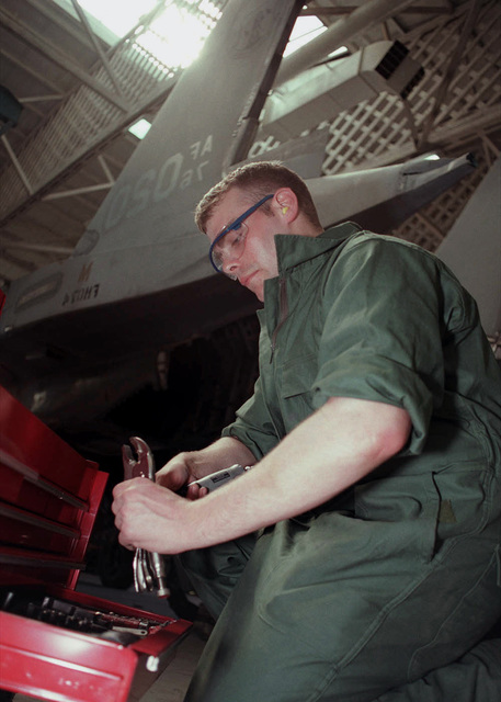 A member of 48th Fighter Wing, Royal Air Force Lakenheath United Kingdom, helps to restore an F-15E Eagle aircraft static display at Imperial War Museum, Duxford, England. The F-15E, which is on loan from the United Sates Air Force Museum, Wright Patterson Air Force Base, is one of about 40 American aircraft on display at the Imperial War Museum