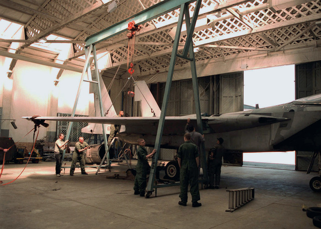 Members of 48th Fighter Wing, Royal Air Force Lakenheath United Kingdom, volunteered to help restore an F-15E Eagle aircraft static display at Imperial War Museum, Duxford, England. The F-15E, which is on loan from the United Sates Air Force Museum, Wright Patterson Air Force Base, is one of about 40 American aircraft on display at the Imperial War Museum