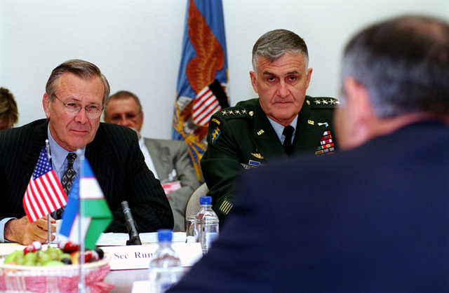 The Honorable Donald H. Rumsfeld (left), U.S. Secretary of Defense, and U.S. Army GEN. Henry H. Shelton (center), Chairman of the Joint Chiefs of STAFF, participate in bilateral security discussions with the Minister of Defense Kodir Gulomov (foreground), of Uzbekistan, at NATO Headquarters in Brussels, Belgium, on Jun. 8, 2001.(DoD photo by Robert D. Ward) (Released)