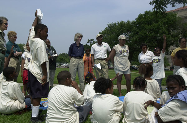 Secretary Gale Norton celebrating Great Outdoors Week on the National Mall, Washington, D.C., joining staff and students from the Wonderful Outdoor World program designed to expose urban youth to outdoor recreational and educational opportunities in their communities
