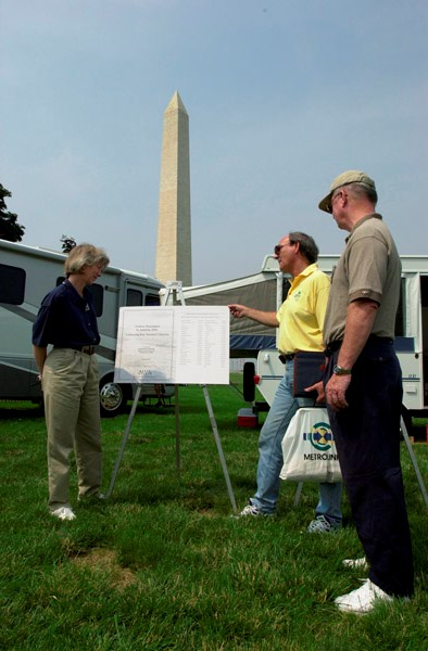 Secretary Gale Norton promoting Great Outdoors Week, and acknowledging the American Recreation Coalition-sponsored report, Outdoor Recreation in America, 2000, at event near the Washington Monument, National Mall, Washington, D.C. To Norton's right is Recreation Coalition President Derrick Crandall