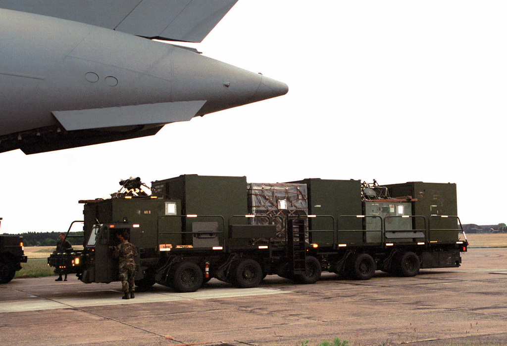 """Members of the 48th Transportation Squadron unload supplies and equipment from a C-17 aircraft on the RAF Lakenheath flightline returning from the Air Expeditionary Force 4 deployment. The pallets were loaded onto the new 60K 'Tunner.' Named after Lieutenant General William H. Tunner, commander of the Combined Airlift Task Force, which provided supplies to West Berlin during the Berlin Airlift. The $1.5 million Tunner is the military's latest """"K Loader,"""" the primary piece of equipment used to load and download cargo from aircraft. The Tunner is capable of holding up to 60,000 pounds or 6 pallet positions of cargo or rolling stock. It can reach speeds up to 24 miles per hour, and can ..."""