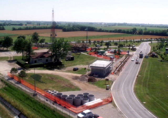 A high-angle view showing a construction project underway at the Main Gate at Aviano AB, Italy. The upgrade project will include a visitors center, a guardhouse, canopy cover, improved road works and landscaping. The project also includes force protection requirements and space for vehicle parking