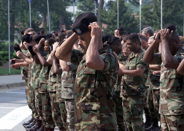 Command Sergeant Major (SGM) Israel Reyes (foreground), Forces Command (FORSCOM), Fort McPherson, GA, leads his platoon in donning their berets during the Beret Ceremony
