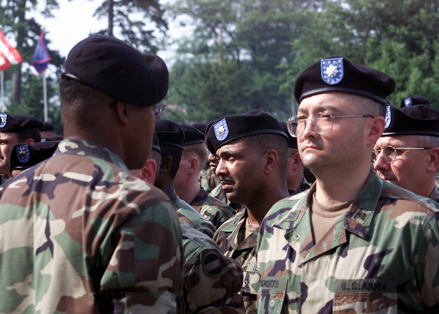 MASTER Sergeant (MSG), Lucius Tucker, Jr., US Army (USA), Forces Command (FORSCOM), checks the placement of the beret worn by Lieutenant Colonel (LTC) Robert O. Bosworth, USA, during the Commands Beret Ceremony