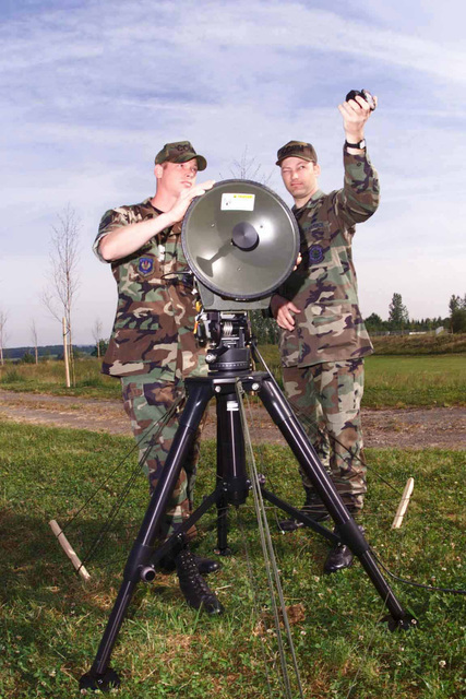 US Air Force STAFF Sergeant Mark Hiers, 52nd Communications Squadron, Network Infrastructure Technician, checks the signal strength from a microwave shot at the relay station while US Air Force Technical Sergeant Andrew Pryor, 52nd Communications Squadron Non Commissioned Officer in Charge of Air Expeditionary Network Systems, checks the azimuth of a shot during a local communications exercise at Spangdahlem Air Base, Germany. Microwave shots give the ability to extend communications services to users at greater distances without running cable