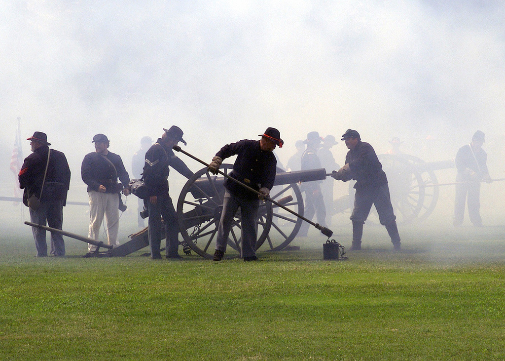 Members of the 9th and 14th Georgia Union/Confederate Field Artillery Units fire their three-inch ordnance rifles (Civil War Era Cannons) as part of the Living History Pageant, during the Armys 226th Birthday Celebration at Fort McPherson GA