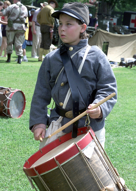 Re-enactor, A. J. Joiner, 11-years old, Company E, 30th Georgia Confederate Infantry, beats out cadence on his drum. A. J. is part of a group participating in a Living History Pageant, during the Armys 226th Birthday Celebration at Fort McPherson GA