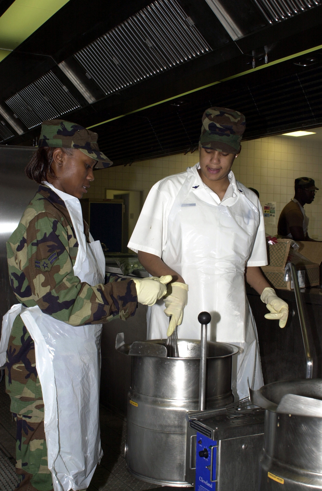 (L to R) AIRMAN 1ST Class Candice Green and AIRMAN Sylvia Byers, food service apprentices, 86th Services Squadron, Ramstein Air Base, Germany, prepare gumbo for dinner at the Rheinland Inn Dinning Facility
