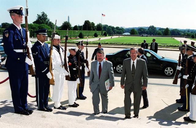 The Honorable Donald H. Rumsfeld, U.S. Secretary of Defense, (right) escorts Minister of Defense Andre Flahaut (left), of Belgium, through an honor cordon into the Pentagon, Washington, D.C., on Jun. 18, 2001.(Dept. of Defense photo by Helene C. Stikkel) (Released)